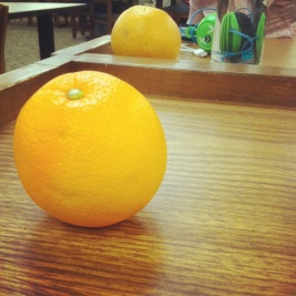 Studying with an orange.